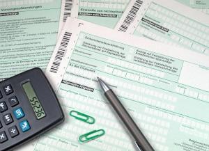 Oft wird die fällige Steuer beim Immobilienverkauf vom Rechner nicht mit einbezogen.